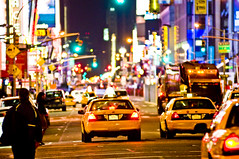 getting cab  times square, new york (andre stoeriko) Tags: new york streets yellow night square lights nikon cab andre times d300 stoeriko nikond300