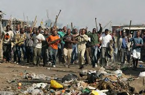 Armed thugs in South Africa carrying out attacks on immigrants. The government has condemned the attacks and deployed the military to restore order in the affected areas of the country. by Pan-African News Wire File Photos