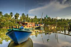 At rest (Dashuki Mohd) Tags: travel sea sky beach nature clouds reflections landscape boats lights evening boat peace afternoon village malaysia hdr fishingvillage kelantan tamron1750mm canon400d awe2020
