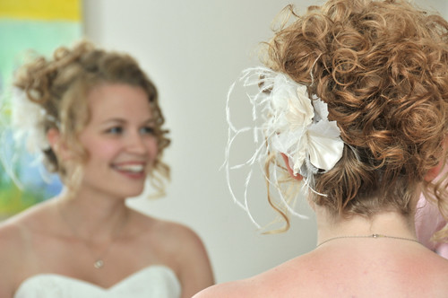 Curly updo wedding hair with flower