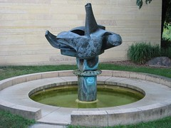 "<p>Title: ""Centennial Fountain""<br/>Sculptor: Raymond I. Jacobson<br/><br/>Accessible to Public: yes, outdoors<br/>Location:Boliou Hall<br/>Ownership: Carleton College<br/>Medium: copper and phos-copper<br/>Dimension: 7 feet high<br/>Provenance: commissioned by the college for its centennial year<br/>Year of Installation: 1966<br/>Physical Condition: requires annual maintenance</p>"