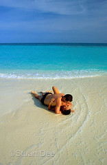 3307-030-01-CoupleBeachMaldives wcr (TravelShooter88) Tags: ocean travel sea color slr beach water canon island sand couple turquoise wave stuart tropical dee embrace maldives whitesand embracing secludedisland romanticcouple stuartdee