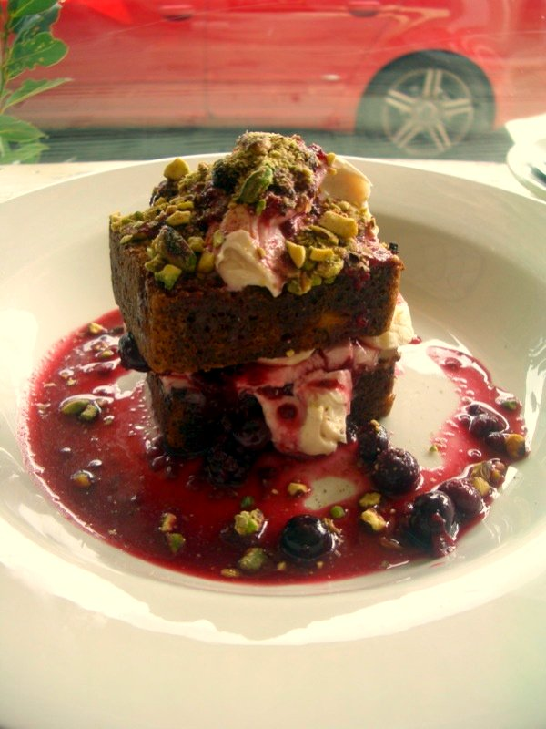 Toasted banana bread with maple syrup mascarpone, fresh banana, berry compote and crushed pistachio