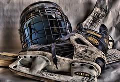 Hockey skate, helmet, and sticks