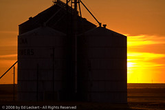 Grain Elevator at Sunset, The Palouse, Washington (edleckert) Tags: summer sky cloud sunlight color nature beauty silhouette horizontal outdoors photography washington twilight unitedstates large nopeople pacificnorthwest northamerica backlit grainelevator scenics adamscounty lind granary canoneos5d beautyinnature placeofwork thepalouse lightingtechnique agriculturalbuilding washingtonsr26