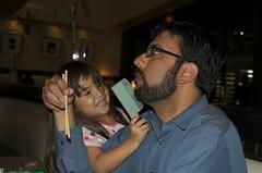 Mina giving a Ashish a shave