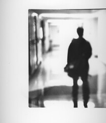 Becoming (aReasontoHope) Tags: shadow lockers project dark education arts blurred center hallway human figure perpich