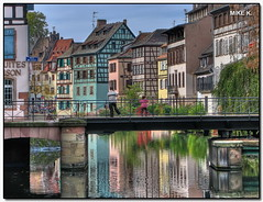 'Petite France' reflections (Mike G. K.) Tags: bridge houses windows roof people plants france reflection water colors girl architecture buildings reflections river restaurant wooden kid colours spectrum timber traditional strasbourg alsace bushes dri petitefrance hdr halftimber timberframed blueribbonwinner photomatix 3exp mywinners hdranything hdrvillage ruedemulins pontdufaisan mikegk:gettyimages=invited