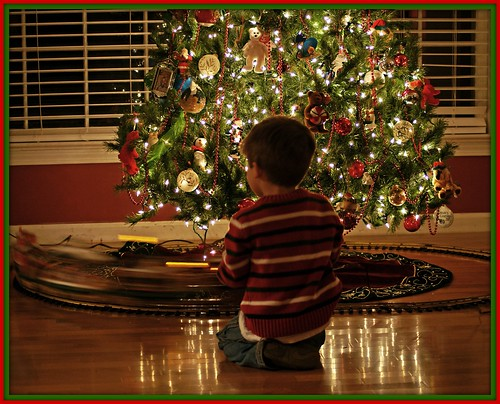 Max playing with the Christmas Train (by lucycarol)