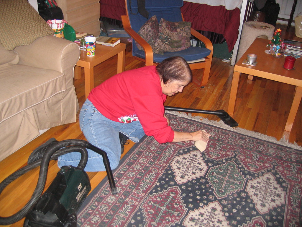 Mom cleaning the rug, on her birthday