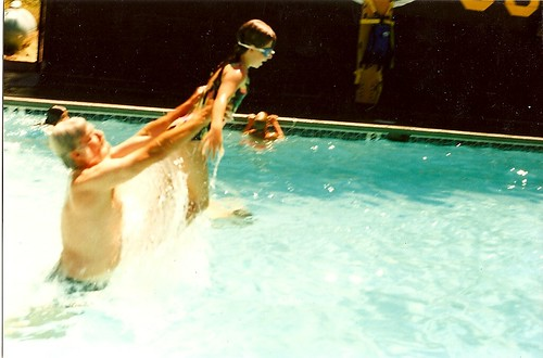 Dad throwing me in the pool at camp