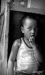 Staring eyes (Reybronx (on and off)) Tags: boy blackandwhite monochrome kid child philippines rustic innocent innocence filipino pinoy mindanao gingoog