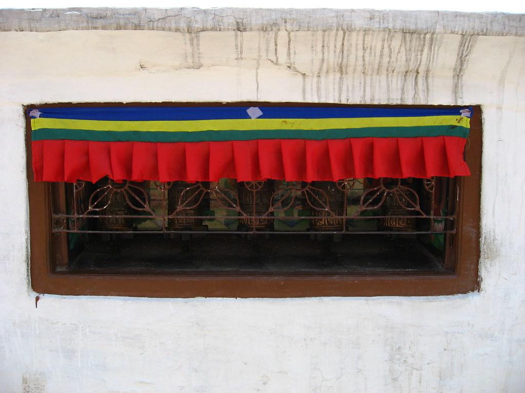 5 of the 108 prayer wheels surrounding the stupa