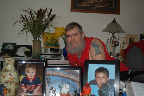 Dad with Pictures of Two Grandsons
