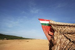Italiano India! (Seema Krishnakumar) Tags: blue red green beach boat colours flag sunny kerala trivandrum adimalathura