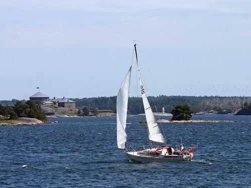 Sailing towards Dalarö A sail boat on the bay close to Höggarn (a nature ...