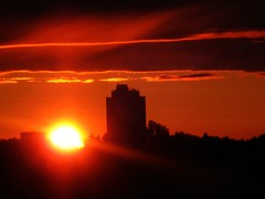 ...and so began a new day (peggyhr) Tags: friends red summer sky orange sun white black yellow clouds sunrise silhouettes explore highrise 444 sunflares peggyhr explorewinnersoftheworld