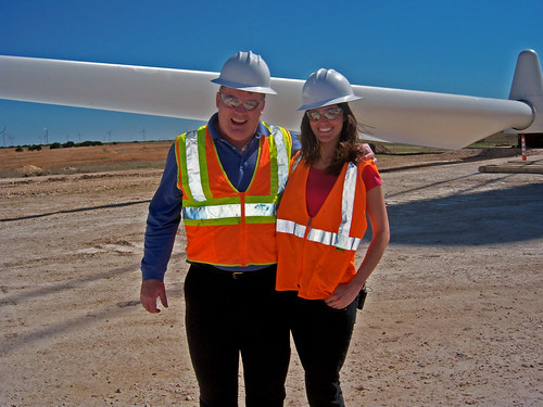 Summer Rayne and Ned Hall, President of AES Energy outside a windmill erection