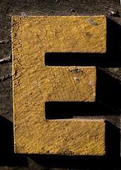 Capital Letter E (Takoma Park, MD) (takomabibelot) Tags: black yellow geotagged maryland e letter takomapark ee oneletter sansserif majuscule oswegoavenue northernvirginiasupplyfleetspecialists geo:lat=38984816 geo:lon=77009439