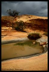 sandstone bluffs (verablue) Tags: newmexico southwest nature water clouds photography sandstone desert mud stormy places 2008 lanscape portfolio3 bazilzerinsky top20nm sandstonebluffs terminalblue