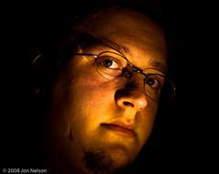 fire (jon.nelson) Tags: light portrait orange selfportrait yellow self fire gold jon darkness nelson 2008