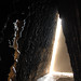"""dark side of the moon - peter zumthor<br /><span style=""""font-size:0.8em;"""">bruder klaus kapelle, germany, completed 2007.<br />architect: peter zumthor, b.1943<br /><br />by nature architecture is a spiritual discipline, reflecting our values, ideas, aspirations. to the trained or sensitive eye, buildings give their makers away, expressing even their greed, opportunism, their base materialism if nothing better is on offer.<br /><br />we perceive this instinctively for the most part, but with religious buildings everybody looks for meaning. in answer, zumthor offers a refined little riddle of a building, at all stages offering us clues, at no time displaying overt symbolism.<br /><br />the interior concrete surface of the chapel makes the old brutalists look a little timid by comparison. as they would have appreciated, it reflects the process of construction, an aspect of architecture neglected by most architects today.<br /><br />in life, we are judged by our actions, and architecture, as ruskin taught us long ago when he established the moral superiority of gothic based on the working conditions of its artisan builders, is no different.<br /><br />for the chapel, zumthor developed a primitive building technique which could be - as I have understood it - executed by the people expected to use it afterwards. <br /><br />trees felled in the vicinity were tied together in a tee-pee shape which became the inner formwork, triangular in section. the outer formwork was a much simpler vertical slipform. a dry concrete mortar was stamped into the cavity between the two forms. finally, a slow-burning fire was lit on the floor, drying out and shrinking the tree trunks, disengaging them but at the same time blackening the walls.<br /><br />the process is explained much better  <a href=""""http://flickr.com/photos/onyone/492461999/"""">here</a>.<br /><br />the building you meet is less primitive than its construction. I was immediately struck by the concrete. the technology of using dr"""