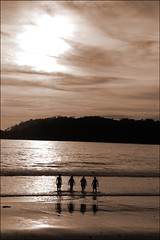 almas gemelas [kindred spirits] (ladyinpink) Tags: ocean people beach sepia landscape togetherness costarica friendship unity strangers cinematography purpose kindredspirits guanacaste playacarillo almasgemelas