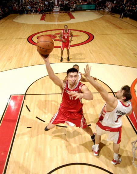 Yao Ming shoots a hook shot over Toronto's Andrea Bargnani