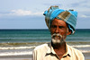 portrait of a fisherman (LindsayStark) Tags: ocean travel portrait man men beach water asia fishermen srilanka humanrights humanitarian trincomalee trinco southasia displaced humanitarianaid emergencyrelief postconflict waraffected conflictaffected overtheexcellence