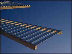 Windmühle (sulamith.sallmann) Tags: blue detail windmill details minimal polen blau minimalism perspektive ausschnitt swinemünde windmühle flügel swinoujscie minimalismus windmühlenflügel sulamithsallmann po0 mühlräder minimalsitisch