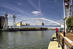 Convergence (Paul Heskes) Tags: docks manchester salfordquays bluesky millenniumbridge docklands salford contrails lowrycentre vapourtrails dockland riverirwell manchestershipcanal salforddocks