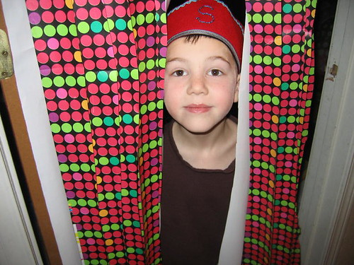 S walking through the birthday curtain