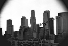 L.A. (aninteger) Tags: sunset blackandwhite reflection skyline buildings 3200 librarytower wronglens
