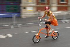 A wing and a wink (jeremyhughes) Tags: orange woman london girl bike race cycling nikon cyclist explore riding d200 condor nikkor wink smithfield criterium bicyclerace bigfish foldingbike racer rapha winking competitor jeremyhughes nikond200 smithfieldnocturne