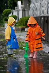 While waiting for Typhoon Fengsheng to hit Manila.. (mylesgj) Tags: rain kids philippines manila raincoat mylesjamito milanjamito audreyjamito