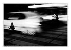 (Hughes Lglise-Bataille) Tags: street shadow blackandwhite bw motion blur paris france topf25 car topf50 crossing noiretblanc streetphoto 2008 topf100 topv1000