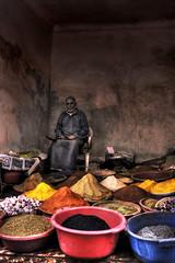 Spice Merchant (oz_jester) Tags: africa old shadow man shop colours muslim islam spice morroco heat marrakech marrakesh seller trader thirdworld 3rdworld secondworld 2ndworld