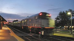Northbound Amtrak Hiawatha train to Milwaukee Wisconsin departing Glenview station at twilight. Glenview Illinois. August 2008.