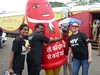 Wake Up Pune team members welcome the inflatable condom to Pune!
