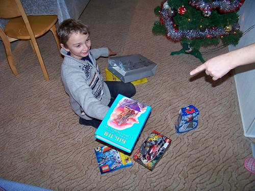 Maxime opening the New Year gifts we gave him including a children's book of Bible stories