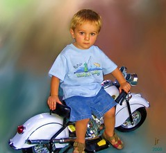 I'm so cool! (Julie's Digital Photo Art) Tags: portrait kids funny loveit views motorcycle sensational 100 babyface corelpainter vpower aplaceforportraits llovemypics portraitunlimited