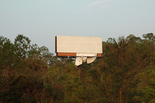 a billboard vinyl ripped blown off white 42 cc web