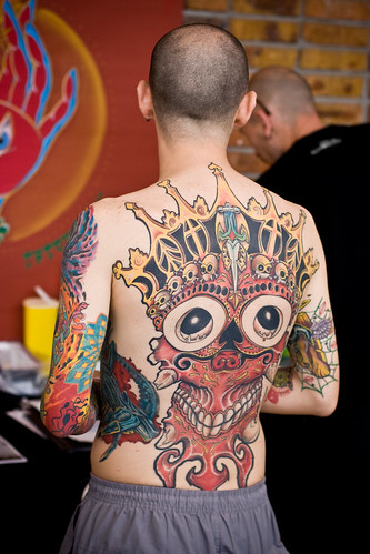 Girl back is beautiful with tattoo skull