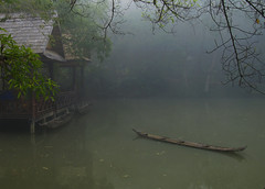 Misty morning  in Luang Prabang, Laos (Anguskirk) Tags: trees sunset nature water pool misty landscape hotel boat pond laos luang prabang indochina hotelvillasantiresort santiresortroadbannadeuayluangprabangluangprabangpobox681laos