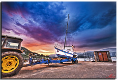 Dawn at Barmouth (Muzammil (Moz)) Tags: uk morning tractor beach beautiful southwales clouds marina landscape manchester photography dawn boad tow moz barmouth mozzy afraaz muzammilhussain