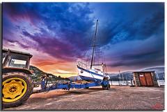 Dawn at Barmouth (Muzammil (Moz)) Tags: uk morning tractor beach beautiful southwales clouds marina landscape manchester photography dawn boad tow moz barmouth mozzy afraaz muzammilhussain