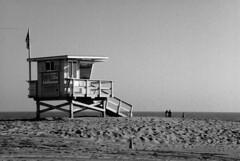 LIfeguard Tower (grokjohn ( john ) .popping in and out.) Tags: ocean california ca summer blackandwhite sun white beach water blackwhite losangeles sand nikon pacific pacificocean socal venicebeach southerncalifornia nikkor 2008 westcoast pacificcoast sunnyday marinadelrey lifeguardtower beautifulday losangelesca veniceca pacifc beachgoers 18200mmf3556gvr venicebeachca d80 nikond80 marinadelreyca summer2008 grokjohn