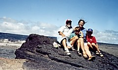 Windy day on the rim of Kilauea caldera, Big Island, Hawaii 1997 (ali eminov) Tags: hawaii islands parents rocks families ali catherine caldera bigisland deniz adem groups lavarock volcanoesnationalpark kilaueacaldera parentsandchildren alieminov ademrudin catherinerudin denizrudin