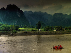 Whitewater rafting on the Nam Song (Bn) Tags: kayaking laos topf100 vangvieng whitewaterrafting eveningglow raftingtrip adrenalinrush 100faves namsongriver limestonemountains rapidwaters limestoneoutcrops wildwatervaren xayohriversidecaf mellowriver exhillarating setofrapids karstrockformation paddlealongtheriver stunninglimestonemountains spectacularformations quietandrapidwaters vissievangvang