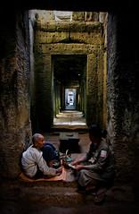 Preah Khan (Lil [Kristen Elsby]) Tags: travel woman archaeology topf25 stone topv2222 temple women asia cambodge cambodia kambodscha southeastasia khmer buddhist buddhism wideangle symmetry unescoworldheritagesite doorway monastery elderly elder aged guide siemreap angkor archeology doorways monastic preahkhan camboya travelphotography camboja worldmonumentsfund